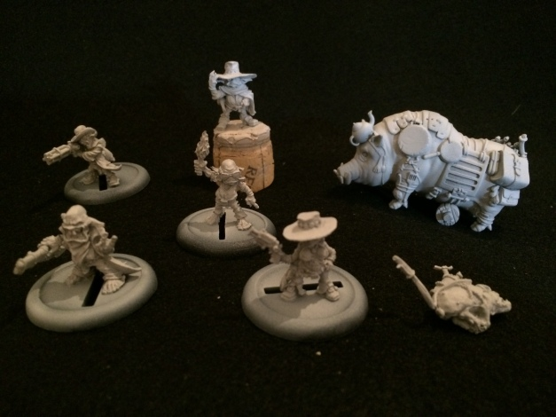 The crew, mounted on temporary bases and undercoated